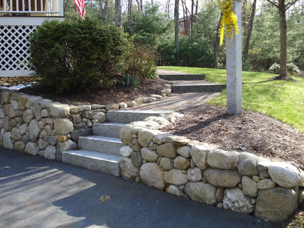 Welcome to tompkins landscaping and for Rock wall garden ideas